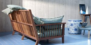 sofa in wood and with cushions made in italy